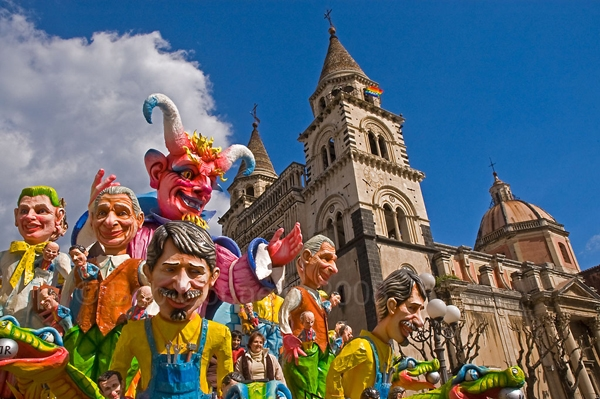 Carnevale in Acireale, Sicily, during the day, with paper mache floats and baroque church